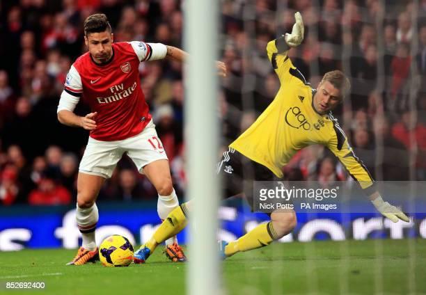Arsenal's Olivier Giroud rounds Artur Boruc to score during the Barclays Premier League match at Emirates Stadium London