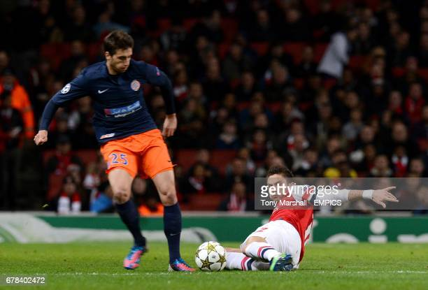 Arsenal's Olivier Giroud slides in to challenge Montpellier's Mathieu Deplagne