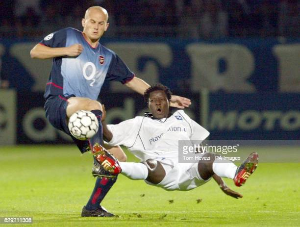 Arsenal's Pascal Cygan and Auxerre's Benjani during their Champions League Group A match at the Stade Abbe Deschamps Auxerre THIS PICTURE CAN ONLY BE...