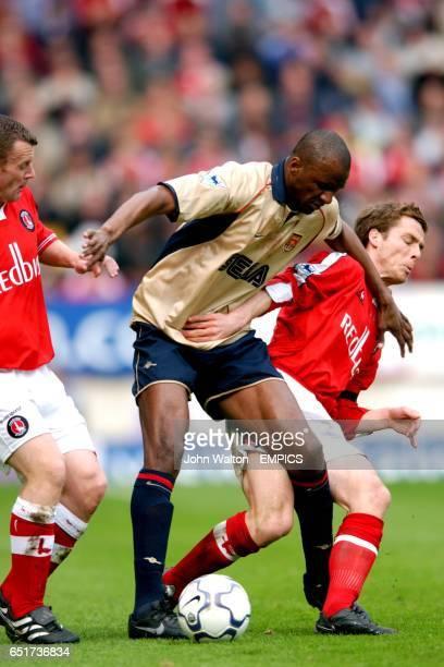 Arsenal's Patrick Vieira battles for the ball with Charlton Athletic's Graham Stuart and Scott Parker