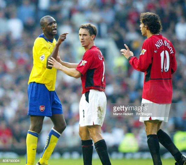 Arsenal's Patrick Vieira points the finger at Manchester United's Ruud Van Nistelrooy following an incident during their FA Barclaycard Premiership...
