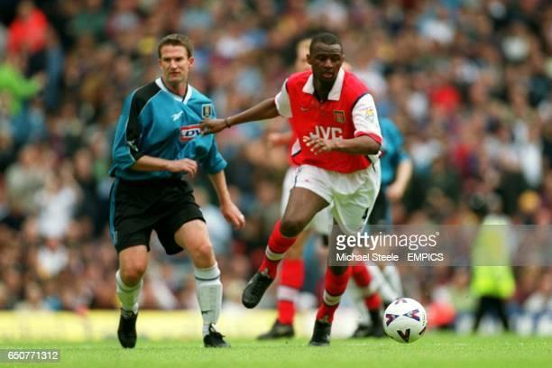 Arsenal's Patrick Vieira runs on past Aston Villa's Simon Grayson