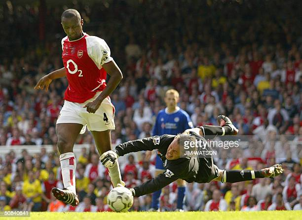 Arsenal's Patrick Vieira scores past Leicester City's goalkeeper Ian Walker during their Premiership football match 15 May 2004 at Highbury in London...