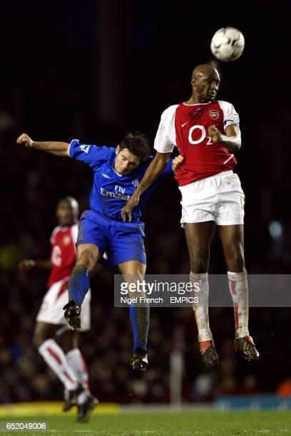 Arsenal's Patrick Vieira wins the header above Chelsea's Frank Lampard
