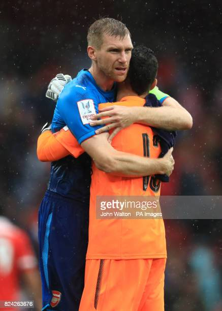 Arsenal's Per Mertesacker and Arsenal goalkeeper David Ospina after the final whistle during the Emirates Cup match at the Emirates Stadium London