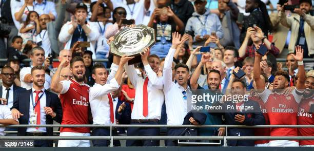 Arsenal's Per Mertesacker and Laurent Koscielny lift the Community Shield after victory at Wembley London