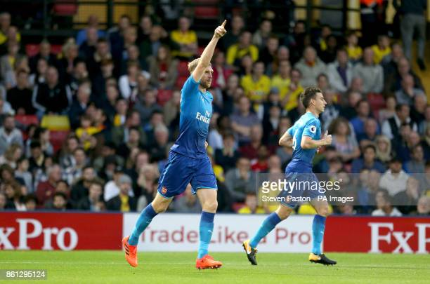 Arsenal's Per Mertesacker celebrates scoring his side's first goal of the game during the Premier League match at Vicarage Road Watford