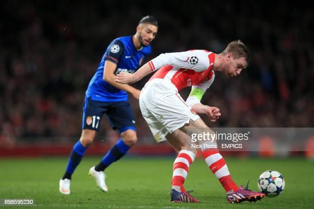 Arsenal's Per Mertesacker clears the ball under pressure from Monaco's Yannick Ferreira Carrasco