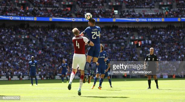 Arsenal's Per Mertesacker gets a facial injury after this clash with Chelsea's Gary Cahill during the FA Community Shield match between Arsenal and...