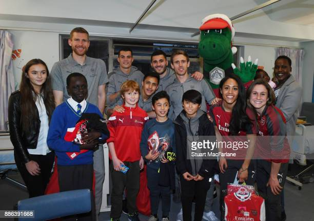 Arsenal's Per Mertesacker Granit Xhaka Alexis Sanchez Sead Kolasinac Nacho Monreal Alex Scott Heather O'Reilly visit the Whittington Hospital on...