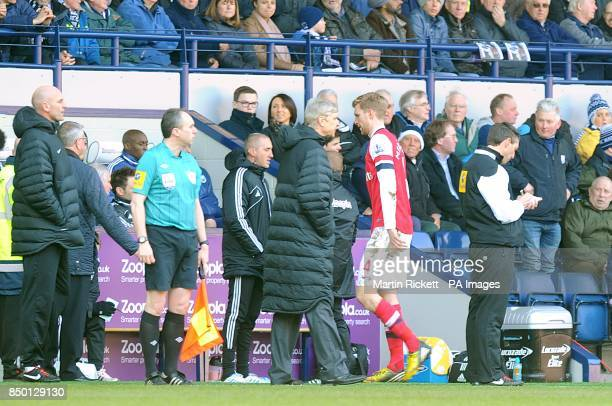 Arsenal's Per Mertesacker walks past manager Arsene Wenger after being shown the red card by referee Howard Webb