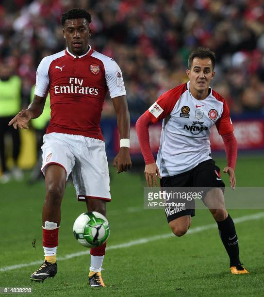 Arsenal's player Alex Iwobi fights for the ball with Western Sydney's player Steven Lustica during a friendly match in Sydney on July 15 2017 / AFP...
