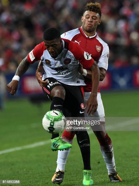 Arsenal's player Alex OxladeChamberlain fights for the ball with Roly Bonevacia of Western Sydney's during a friendly game in Sydney on July 15 2017...