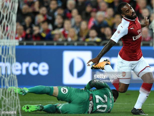 Arsenal's player Alexandre Lacazette fights for the ball with Western Sydney's goalkeeper Vedran Janjetovic during a friendly match in Sydney on July...
