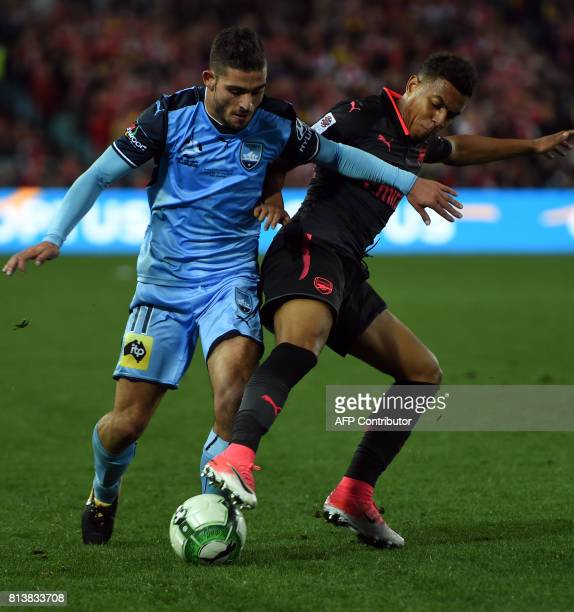 Arsenal's player Donyell Malen battles for the ball with Sydney FC's player Nicola Kuleski during their football friendly match in Sydney on July 13...