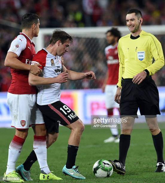 Arsenal's player Granit Xhaka engage in a fight with Western Sydney's player Jacob Melling during a friendly match in Sydney on July 15 2017 / AFP...