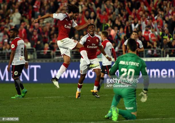 Arsenal's player Mohamed Elneny celebrates his goal as Western Sydney goalkeeper Vedran Janjetovic looks on during a friendly match in Sydney on July...