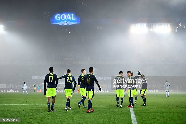 Arsenal's players celebrates after scoring their fourth goal during the UEFA Champions league Group A football match between FC Basel 1893 and...