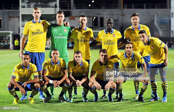 Arsenal's players pose before their UEFA Champions League group F football match Marseille vs Arsenal on September 18 2013 at the Velodrome stadium...