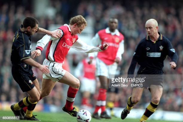 Arsenal's Ray Parlour takes on Southampton's Francis Benali and Chris Marsden