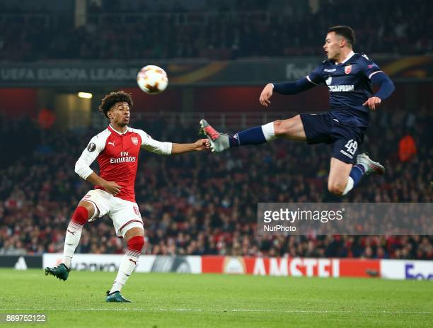 LR Arsenal's Reiss Nelson and Nemanja Radonjic of Red Star Belgrade during UEFA Europa League Group H match between Arsenal and Red Star Belgrade at...