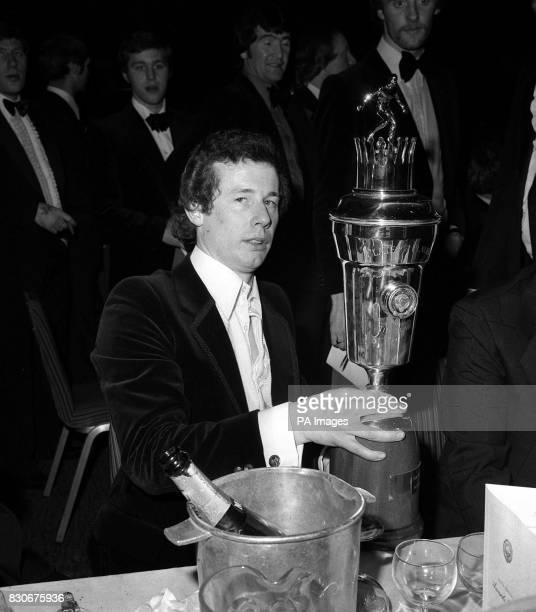 Arsenal's Republic of Ireland international Liam Brady receives the Professional Footballers Association Player of the Year trophy at the London...