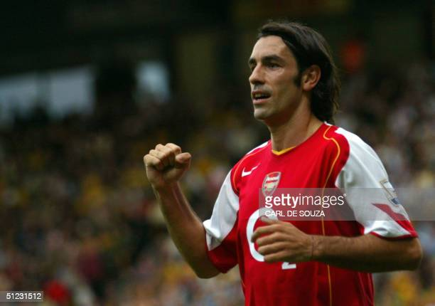 Arsenal's Robert Pires celebrates his goal against Norwich in a Premiership match 28 August 2004 at Norwich AFP PHOTO/CARL DE SOUZA NO TELCOS...