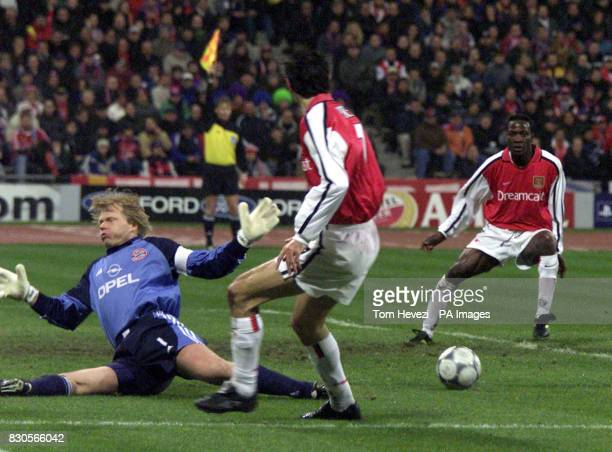 LEAGUE Arsenal's Robert Pires passes the ball past Bayern Munich's goalkeeper Oliver Khan to team mate Lauren who goes on to score but his goal is...