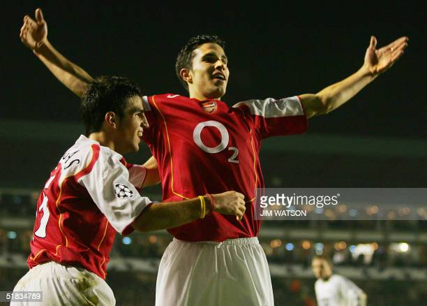 Arsenal's Robin Van Persie celebrates scoring against Rosenborg with teammate Cesc Fabregas during their Champions League football match at Highbury...