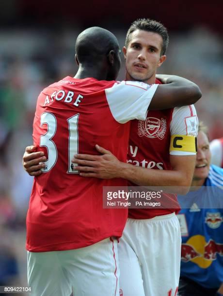 Arsenal's Robin Van Persie celebrates scoring the opening goal with Benik Afobe during the Emirates Cup match at the Emirates Stadium London