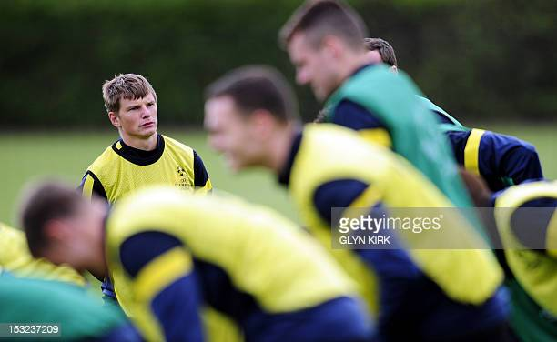 Arsenal's Russian midfielder Andrey Arshavin attends training for the UEFA Champions League group B football match against Olympiakos at their...