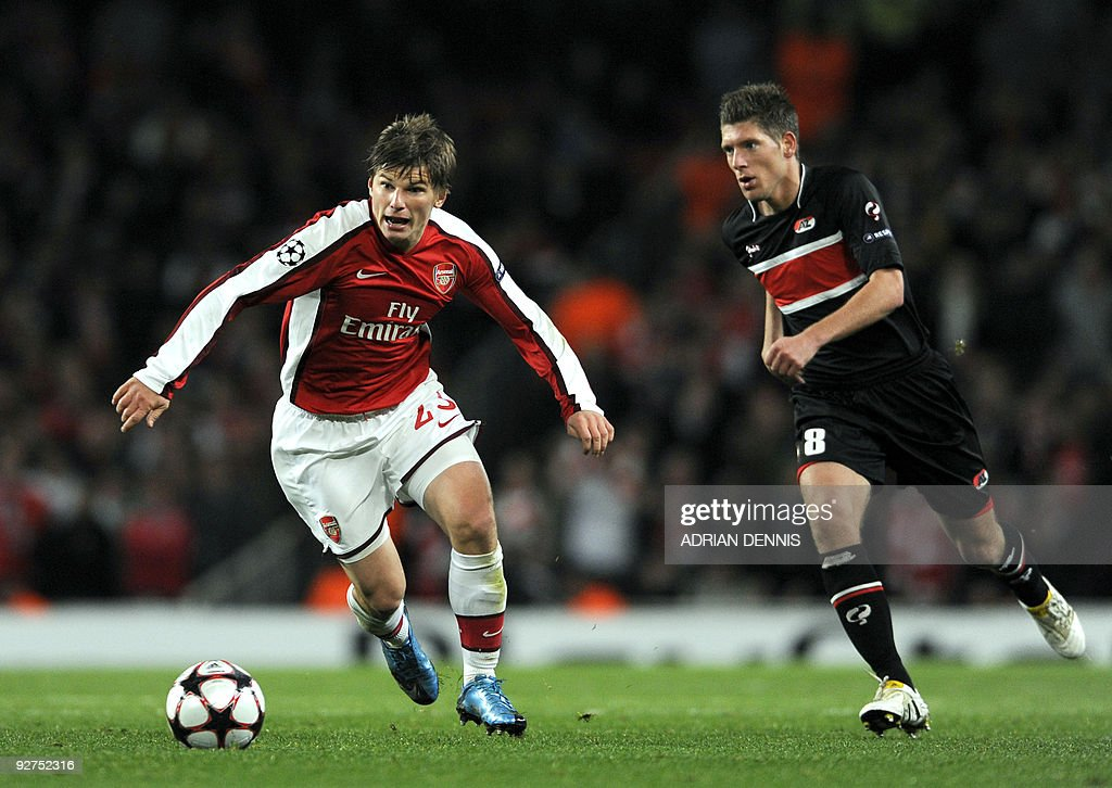 Arsenal's Russian midfielder Andrey Arshavin vies for the ball against AZ Alkmaar's Stijn Schaars during the Champions League Group H football match...