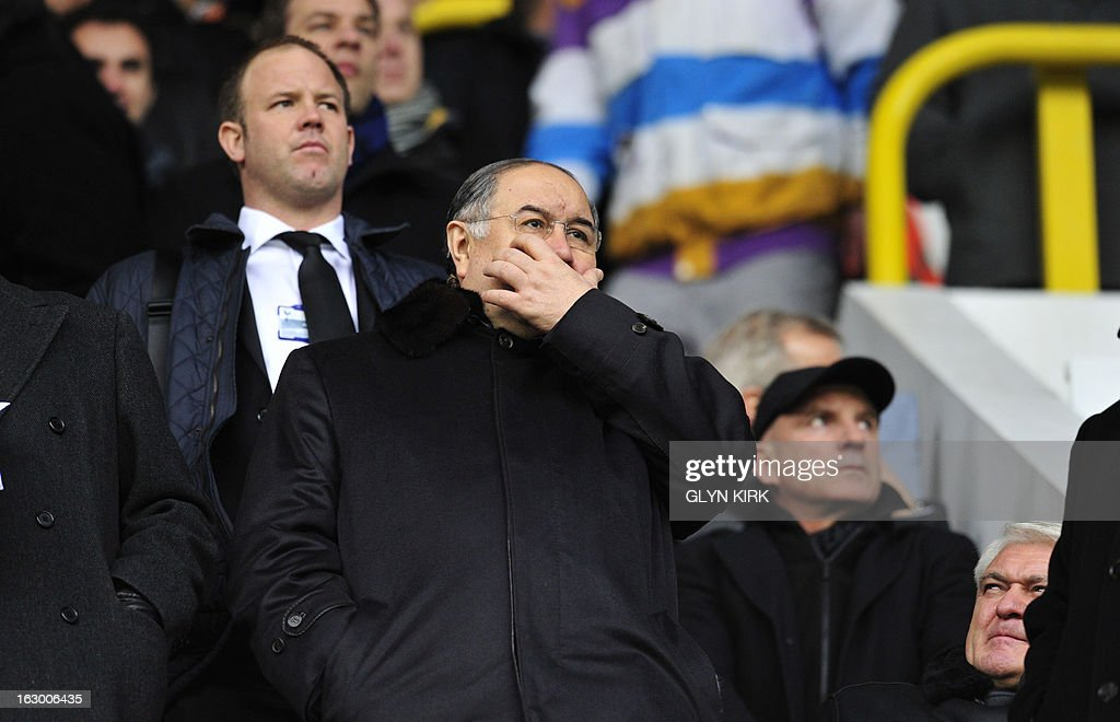 "Arsenal's Russian shareholder Alisher Usmanov (C) looks on before the English Premier League football match between Tottenham Hotspur and Arsenal at White Hart Lane in north London on March 3, 2013. AFP PHOTO/GLYN KIRK USE. No use with unauthorized audio, video, data, fixture lists, club/league logos or ""live"" services. Online in-match use limited to 45 images, no video emulation. No use in betting, games or single club/league/player publications"