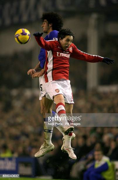 Arsenal's Samir Nasri and Everton's Marouane Fellaini battle for the ball