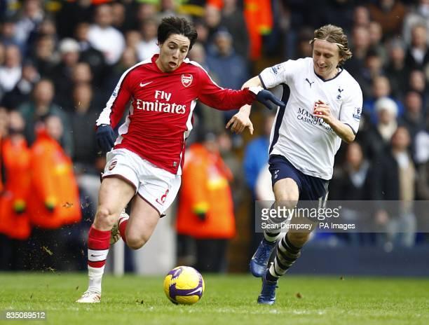 Arsenal's Samir Nasri and Tottenham Hotspur's Luka Modric battle for the ball