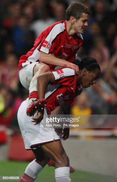 Arsenal's Sanchez Watt celebrates the 3rd goal against Liverpool with Jack Wilshere during the FA Youth Cup Final First Leg at the Emirates Stadium...