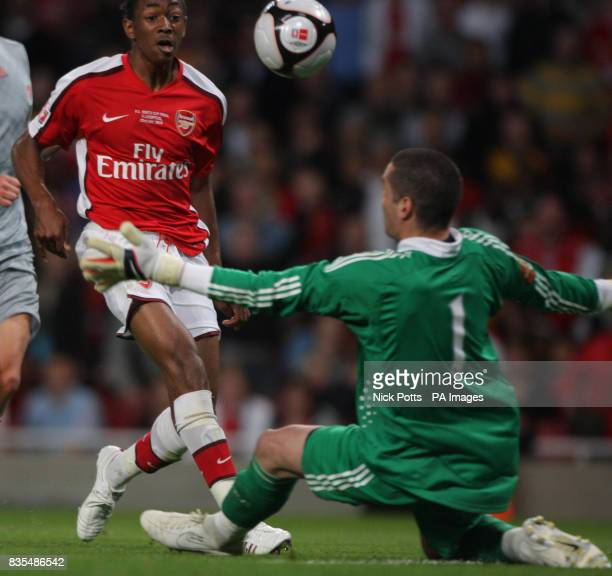 Arsenal's Sanchez Watt scores the 3rd goal beating Liverpool keeper Dean Bouzanis during the FA Youth Cup Final First Leg at the Emirates Stadium...
