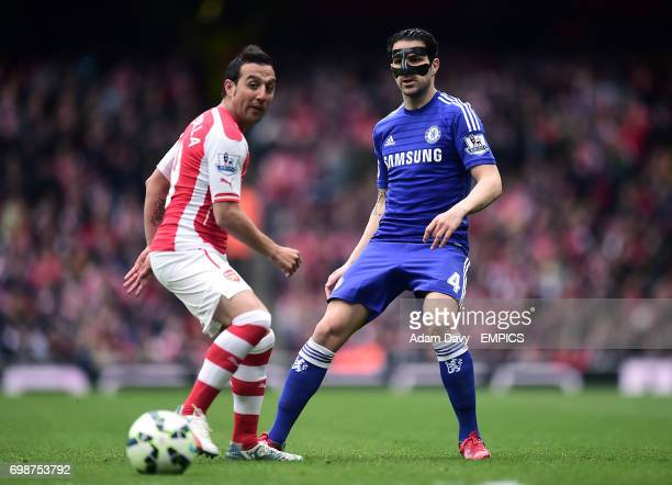 Arsenal's Santi Cazorla and Chelsea's Cesc Fabregas battle for the ball