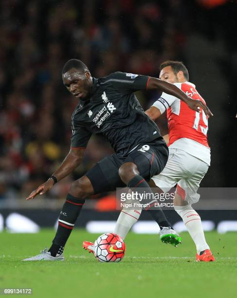 Arsenal's Santi Cazorla and Liverpool's Christian Benteke battle for the ball
