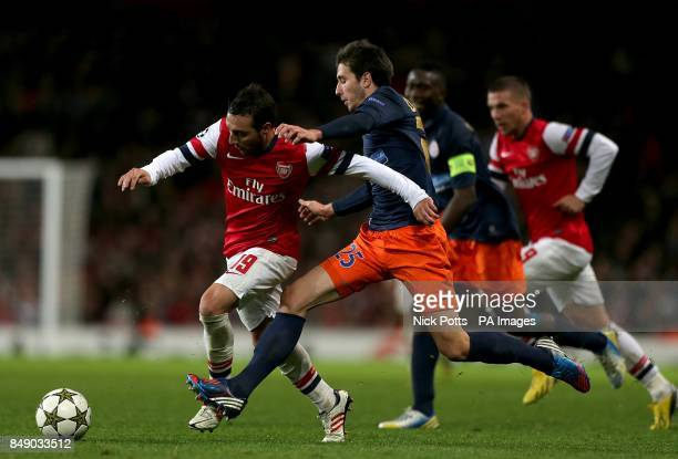 Arsenal's Santi Cazorla and Montpellier's Mathieu Deplagne in action