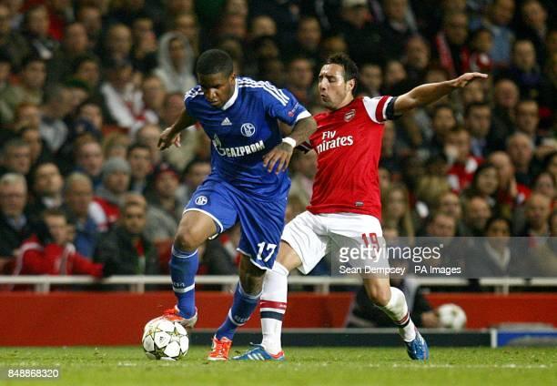 Arsenal's Santi Cazorla and Schalke 04's Jefferson Farfan battle for the ball