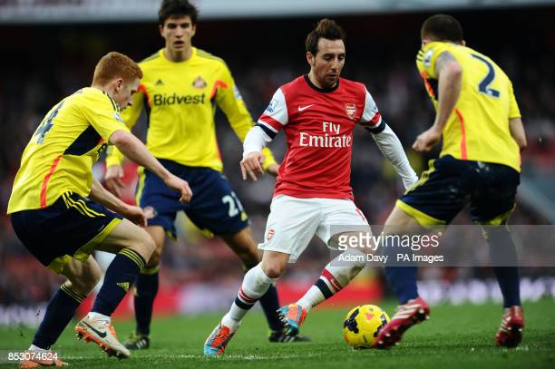 Arsenal's Santi Cazorla and Sunderland's Jack Colback with Phil Bardsley during the Barclays Premier League match at the Emirates Stadium London