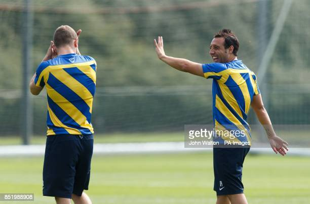 Arsenal's Santi Cazorla has a laugh during a training session at London Colney St Albans