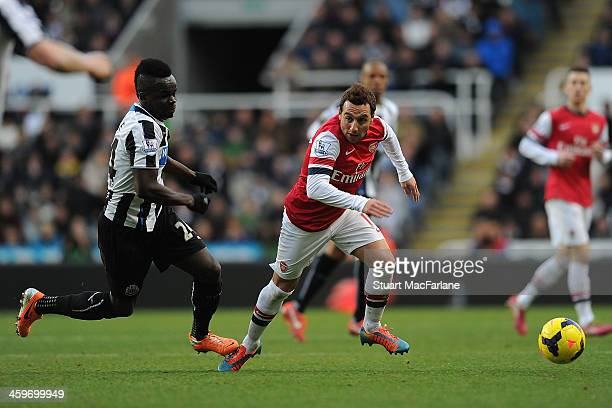 Arsenal's Santi Cazorla is caught by Newcastle's Cheick Tiote during the Barclays Premier League match between Newcastle United and Arsenal at St...