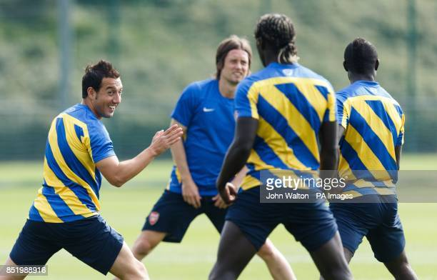 Arsenal's Santi Cazorla smiles during a training session at London Colney St Albans