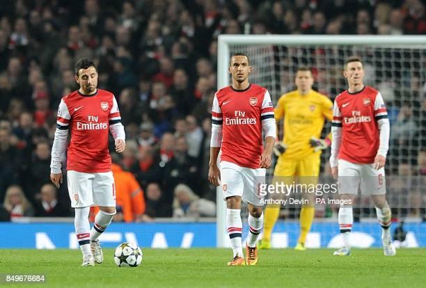 Arsenal's Santi Cazorla Theo Walcott Wojciech Szczesny and Laurent Koscielny stand dejected after Bayern Munich's Daniel Van Buyten scores their...