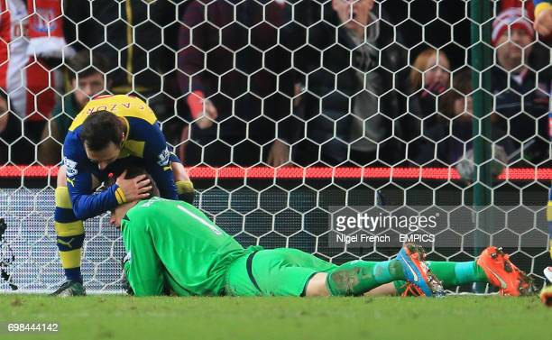 Arsenal's Santi Cazorla tries to retrieve the ball from Stoke City's Asmir Begovic after scoring his sides first goal of the game
