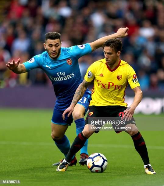 Arsenal's Sead Kolasinac and Watford's Kiko Femenia battle for the ball during the Premier League match at Vicarage Road Watford