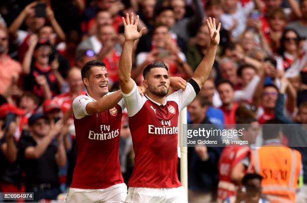 Arsenal's Sead Kolasinac celebrates scoring his side's first goal of the game with Granit Xhaka during the Community Shield at Wembley London