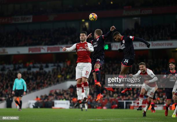 Arsenal's Sead Kolasinac flicks the ball on during the Premier League match between Arsenal and Huddersfield Town at Emirates Stadium on November 29...